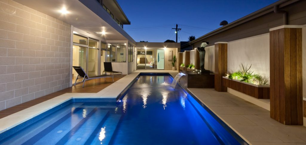 Compass Pools Fastlane fibreglass lap pool with external steps and waterwall feature